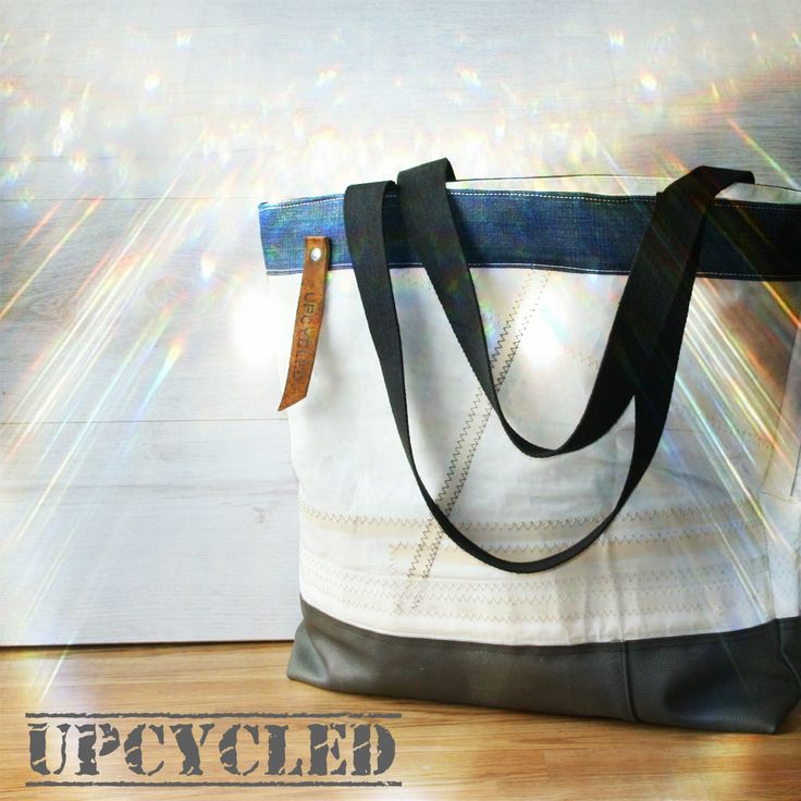 Upcycled sail bag. Sail, leather from an old couch and reused jeans. Nice recycling.