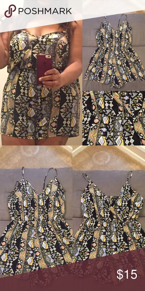 Plus Size Playsuit Tribal print size 1X (flowy so it fits a 2X -my current size), wrap top w/ small snap in front...elastic in waist. Forever 21 Pants Jumpsuits & Rompers