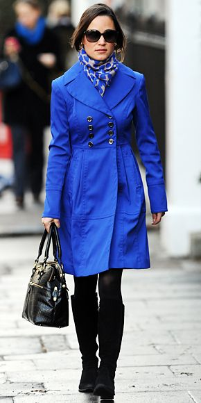 Pippa Middleton was out and about in London in a royal blue double-breasted coat, which she paired with her trusty Russell and Bromley boots, Beulah London scarf and signature Modalu bag