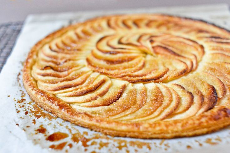 "Caramelized Apple Tarte Fine Recipe by chocolateandzucchini: A tarte fine — literally, ""thin tart"" — is a classic type of French tart assembled on a flat disk of puff pastry, with no raised borders. This means it requires no tart pan! #Tarte #Apple #Easy"