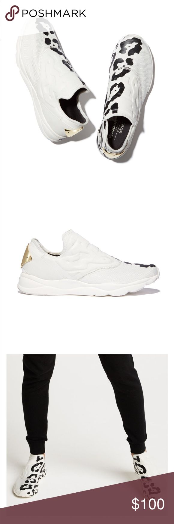 NWT Reebok furylite slip-on sneakers NWT Reebok furylite slip-on sneakers   goop exclusive print, completely sold out!  The black-on-white rosette print and mirrored gold accent heel makes these comfortable, breathable, slip-on performance sneakers as chic as they are functional. Reebok Shoes Sneakers