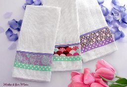 Sew4Home shows how to embellish tea towels with ribbon and fabric.  The simple addition takes a plain towel and makes it special.  Choose colors and patterns that match your kitchen for perfectly c…