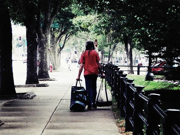 Just Another Day by Cattura - A homeless man walking around in a big city, just another day