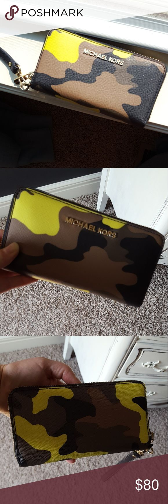 Michael Kors Jet Setter Wristlet Wallet Michael Kors Jet Setter Wristlet Wallet. Camo wristlet wallet with credit card slots, phone slot, open compartments & zipper section. You can fit a lot in here! The glazing around the edges is not perfect (see photos). Not noticable when worn.  Saffiano leather in perfect condition.  Nice interior as well. Michael Kors Bags Wallets