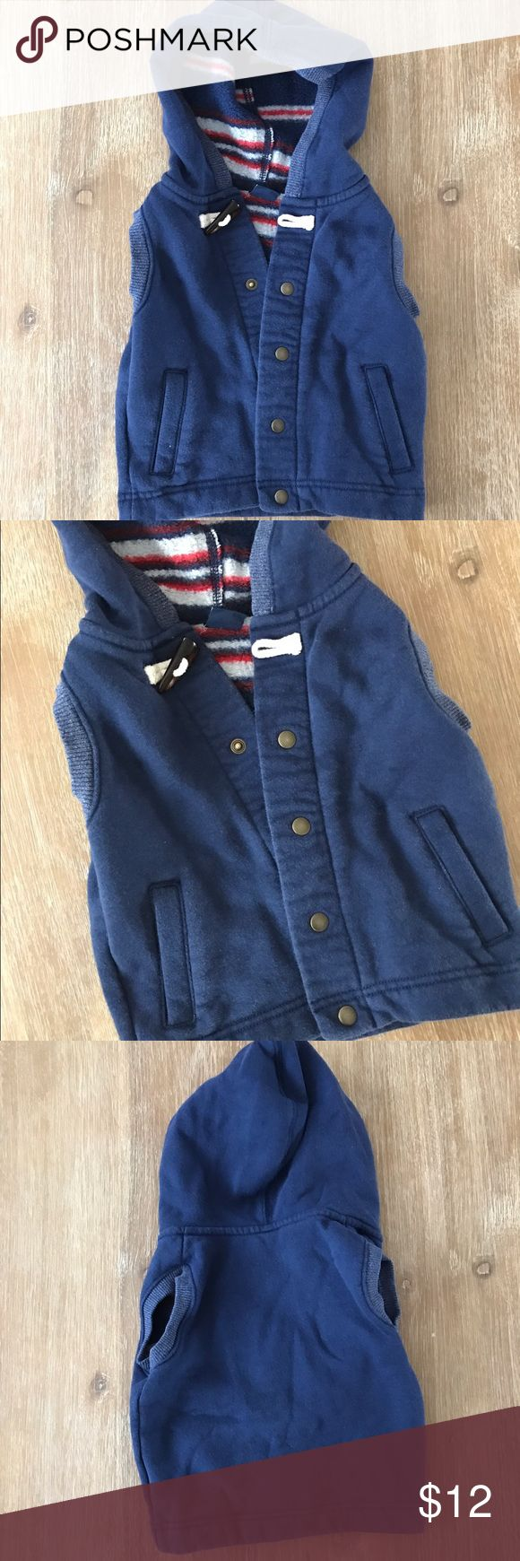 BOYS GAP Navy Blue Vest 6-12 Months Cozy navy blue vest with hood. Pockets. Snaps. GAP. 6-12 months. Cute for boy or girl. OFFERS WELCOME | BUNDLE FOR DISCOUNT | MORE ITEMS COMING GAP Jackets & Coats Vests
