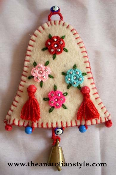 Felt Bell @elvanfigen: These decoration stuff was made from felt by my husbond's aunt. It was traditional decorations from turkey that is a small villige called Nallihan. Top of the felt there are and crocheted flowers and decorated with beads. (Very Beautiful.)