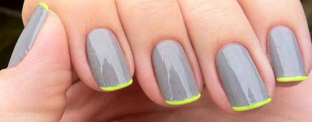A pop of neon brightens monochromatic nails. | 25 Eye-Catching Minimalist Nail Art Designs