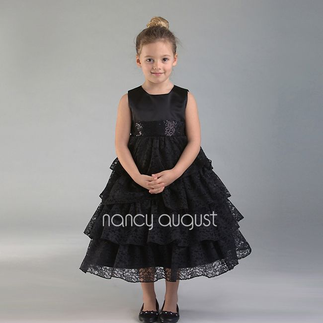 The Elegant Chic Black Lace Tiered Dress: This vintage inspired black lace dress is complete and utter chic. This lace dress features a satin sleeveless bodice with an overlay tiered lace skirt. The waist is accented with hand-sewn squiggly sequin embroidered design on the waistband. This black lace flower girl dress is versatile and will be perfect for any special occasion such as summer outdoor weddings. Be sure to visit our accessories collection to complete the ensemble!