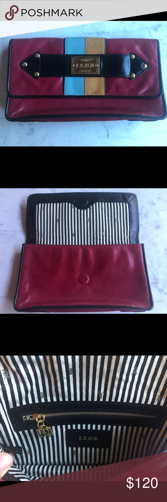 """LAMB hard to find Red Clutch Red clutch with baby blue and beige stripe. Strap in the face to slip your hand in. Gold hardware and interior zipper. Interior fabric is classic black and white stripe with LAMB logo. A couple light scratches (you have to really look for them). No Stains. No wear on edges and corners.  Rarely used.  A perfect size clutch with style and a little edge.  Size:11""""w X 6""""L x 1.5""""D L.A.M.B. Bags Clutches & Wristlets"""