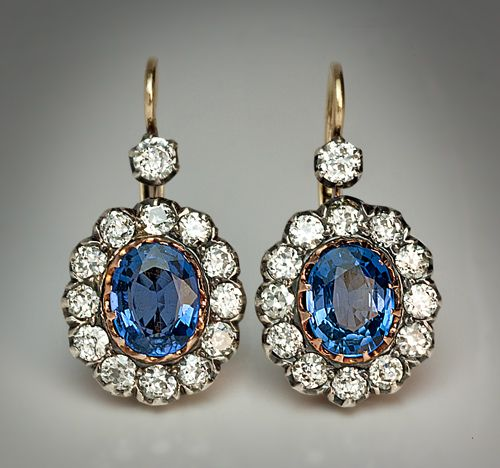 Vintage Sapphire and Diamond Cluster Earrings Moscow, circa 1915 A pair of leverback silver topped 14K gold earrings set with two oval blue sapphires (esti