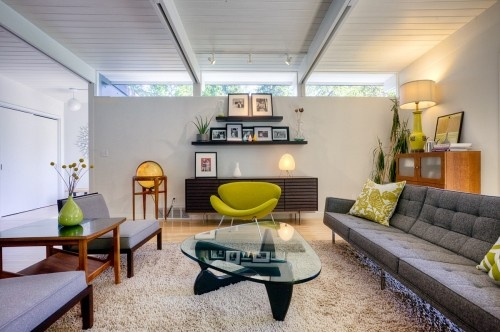 Bright Midcentury-Modern House in Seattle  The green Orange Slice Chair, originally designed by Pierre Paulin in 1960, is the focal point in the living room.