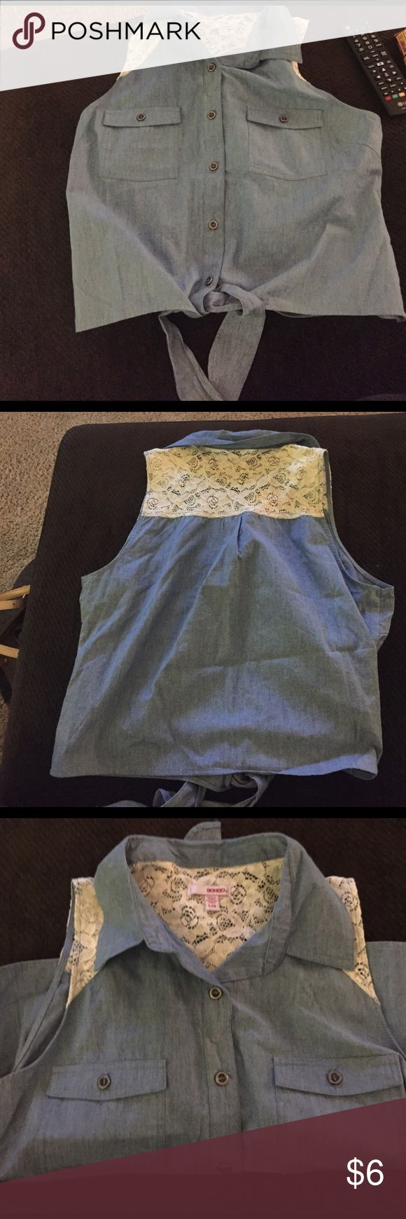 Sleeveless denim shirt Sleeveless denim button up shirt with lace material on the back on top. Never worn. Tops