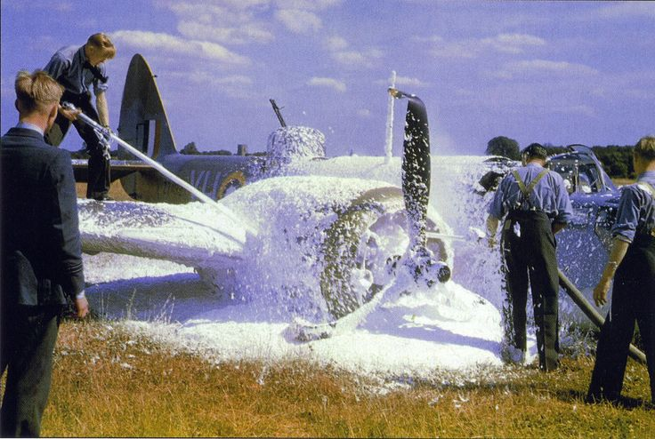 RAF firefighters are quick to put out an engine fire on this Bristol Blenheim.