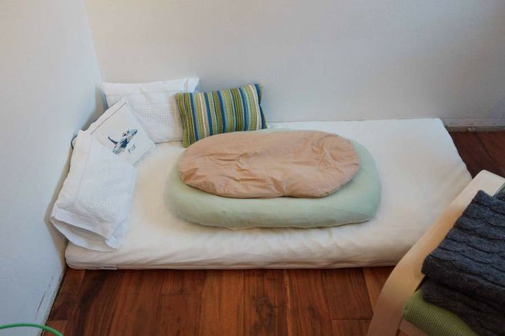 Montessori floor bed with newborn topper