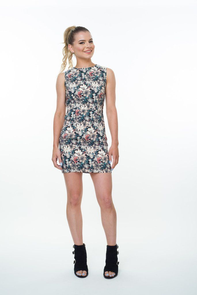 Get flirty with this sleeveless floral print dress. Offering a sexy backless design and a slight stretch combining functionality and style.  Lining: Fully Lined Sheer: None Sheer Our model is wearing size 8 This is a smaller fit dress, we recommend you purchase one size up.