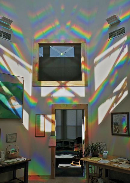Light is refracted through plastic panels to create rainbow patterns inside the CoHo Ecovillage Commons House. Peter Erskine created the piece called 'Inside a Diamond.'