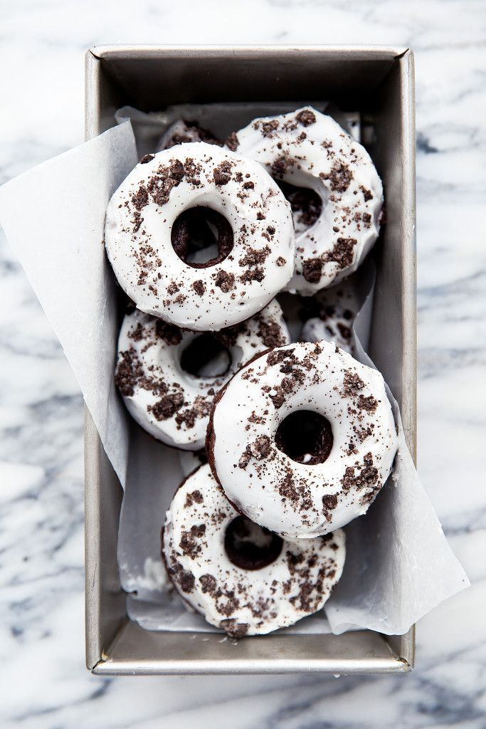 chocolate donuts with crushed oreo cookies and a vanilla glaze