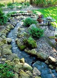 Backyard Landscaping on Pinterest. Water feature that can wrap around the house. Make it a dry riverbed in late fall/winter. Start again when it thaws.