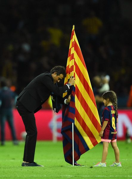 Luis Enrique manager of Barcelona places a Barcelona flag in the pitch after the UEFA Champions League Final between Juventus and FC Barcelona at Olympiastadion on June 6, 2015 in Berlin, Germany.