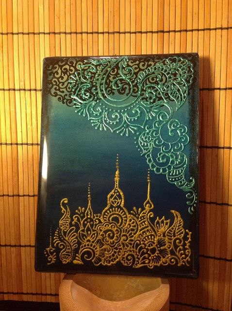 Henna design on canvas using fabric paint and resin