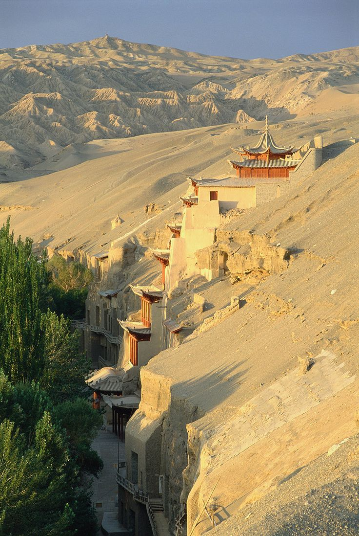 The Mogao Caves or Mogao Grottoes, also known as the Caves of the Thousand Buddhas, form a system of 492 temples 25 km (16 mi) south-east of the centre of Dunhuang, an oasis strategically located at a religious and cultural crossroads on the Silk Road, in Gansu province, China.