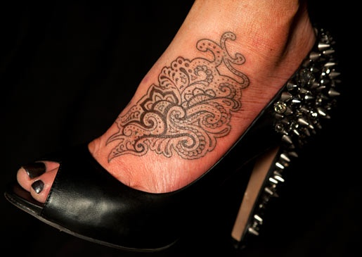 not only is this tattoo awesome, but so are her shoes!