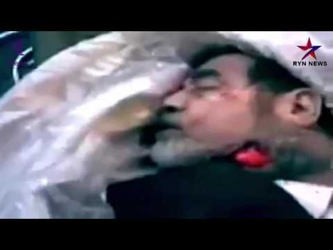 video of Saddam Hussein seep into the hospital after execution