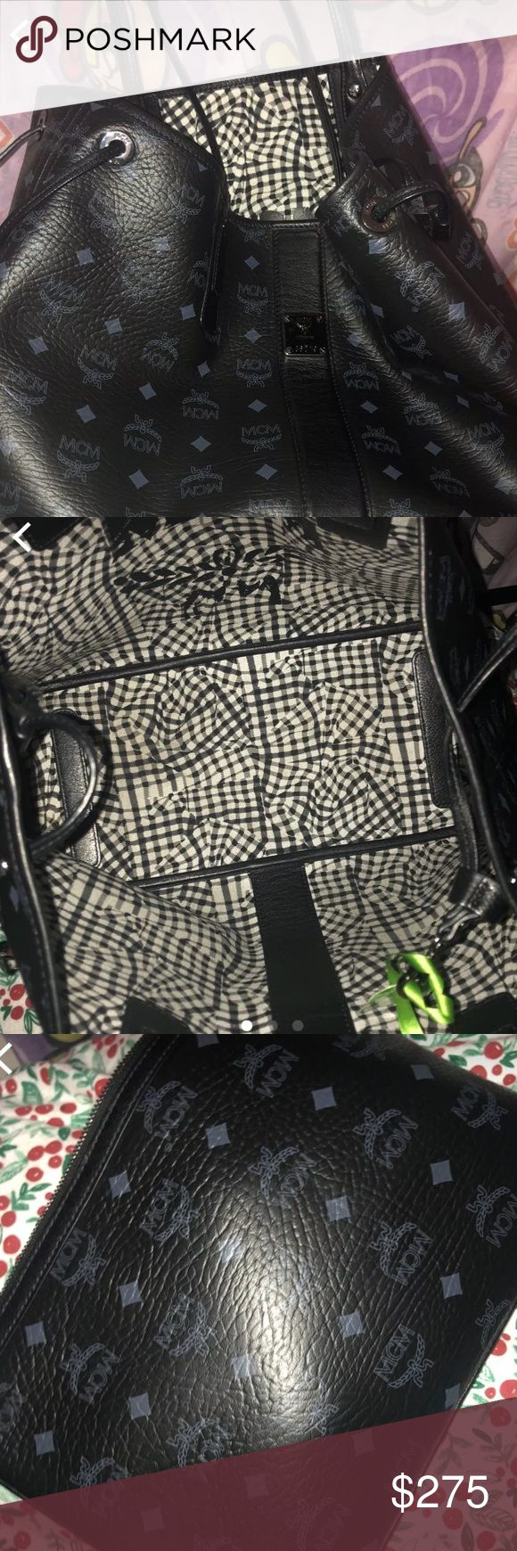 MCM Medium Tote Like New black medium mcm tote ..does include clutch and dustbag... original price is $590.00 ! Please text 917-259-3702 before purchasing (because i am selling it outside of this website as well) . and also to negotiate a price. MCM Bags Totes