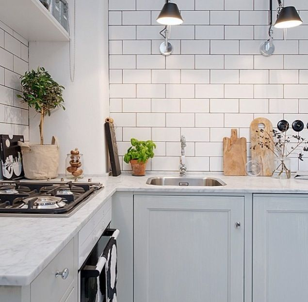 Again a marble worktop but the metro tiles and on-trend grey kitchen units modernise the look.