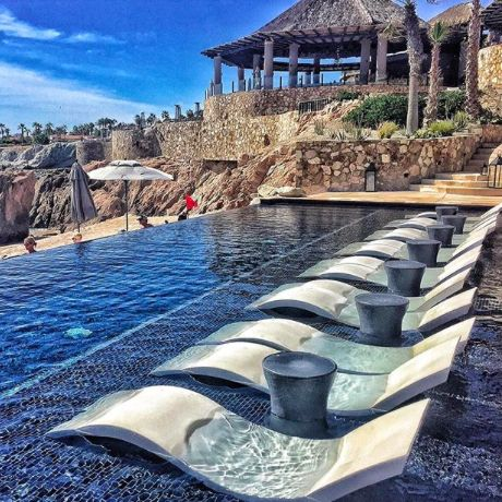 The only way to lay by the pool - in the pool, in sun loungers in the water at Esperanza in Cabo San Lucas, Mexico