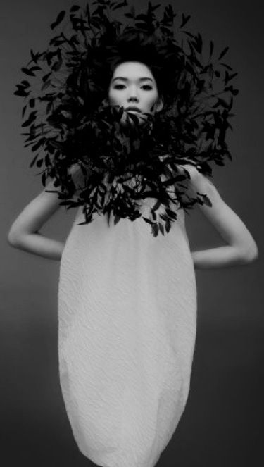 Sculptural Fashion with dramatic black feathers; creative fashion; wearable art