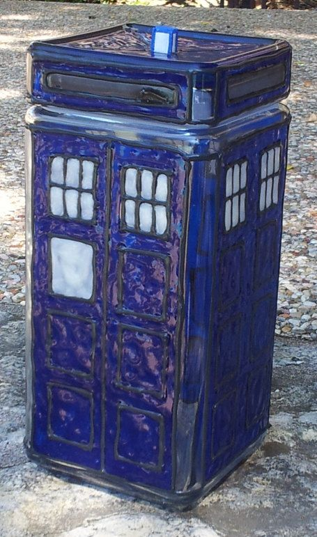 TARDIS themed cookie jar, created from faux stained glass materials upon a sturdy glass jar. It is topped with a resin cast of the TARDIS's lamp light, which was then hand-painted and sealed for a lasting finish.