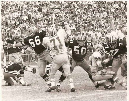 """Tom Dempsey Here is one of 4 field goals he kicked against the Detroit Lions during that 1970 regular season game at Tulane Stadium. Later, with time running out, he would kick the NFL record 63-yarder to defeat the Lions 19-17. That record would stand for over 40 years.  """"Wild"""" Bill Cody, #66 in the picture. Sent me this picture. Cody played linebacker as well special teams and was one of the original Saints in 1967.  Also pictured are Saints Jake Kupp (#50), Mike Taylor (#77), Joe Scarpati…"""