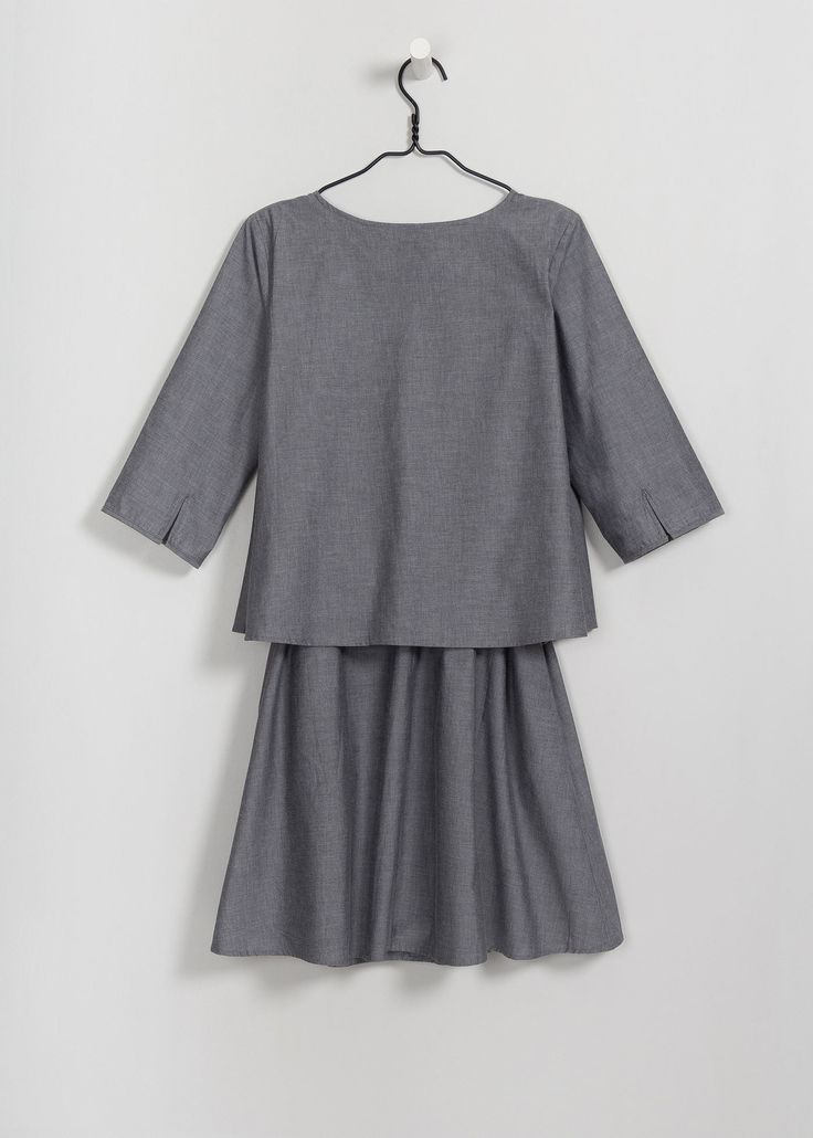 Double layered dress with bound hem sleeves and side seam pockets. Comes with self fabric belt. Made from premium 100% certified fair trade organic cotton poplin.      Chest Front Length from Shoulder Sleeve Length     XS 102cm 101.5cm 43cm   S 107cm 103cm 44cm   M 112cm 104.5cm 45cm   L 117cm 106cm 46cm   XL 122cm 107.5cm 47cm    Marnie is 175cm/5'9