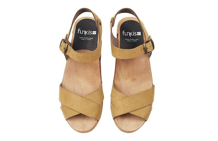 Add a pop of colour with Funkis mustard clogs.
