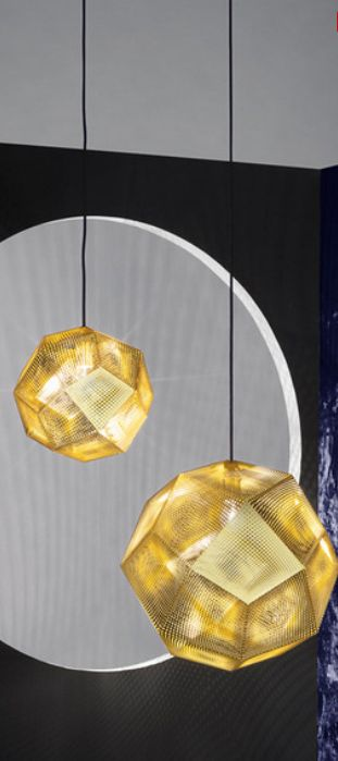 The Tom Dixon Etch Shade 50cm Brass has a detailed pattern which casts a mass of intricate shadows when lit.