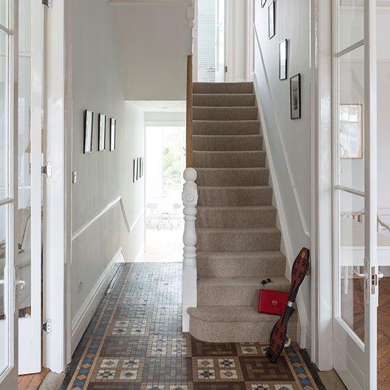 Modern white hallway with rocking chair   Hallway decorating   housetohome.co.uk