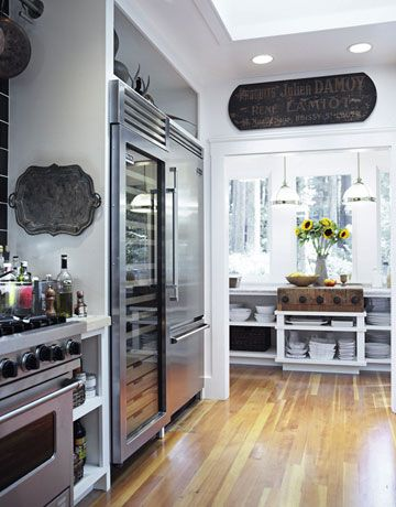 I like the black and white from House Beautiful's Tyler Florence's kitchen of the year '11.  I wonder about incorporating this idea with a bit of gray into my kitchen.
