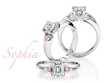 3 stone diamond ring with 2 pink diamonds of course!