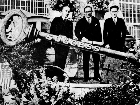Big from the start, MGM was formed as a merger of Metro, Samuel Goldwyn and Louis B. Mayer film companies. On the stand at the Hollywood studio dedication are Louis B. Mayer, head of the new company, flanked by Harry Rapf (left) and Irving Thalberg (right), who shared production responsibilities, April 24, 1924.