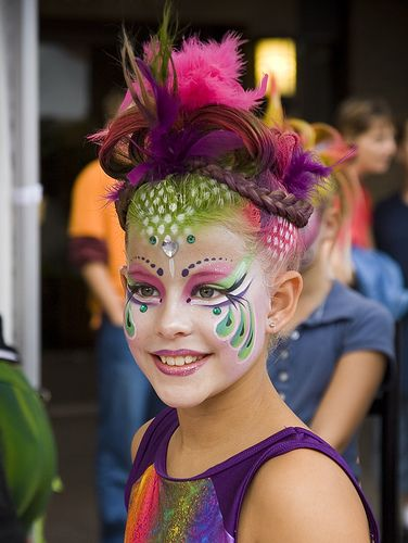 Very creative colorful crystal accented face painting.