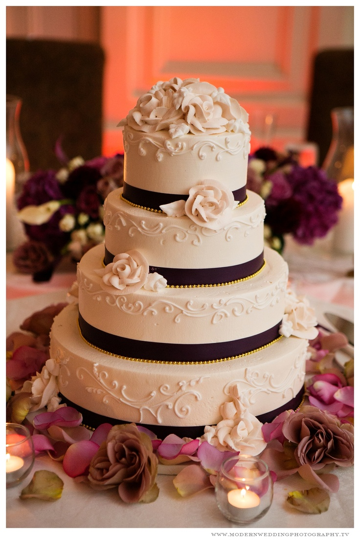 I like the scroll work on the sides. That's a very pretty design. I also like the size ratio between the layers of cake.  I don't like ribbon on cake, but I love roses! I'd want coral fresh flowers, though. Not necessarily roses only.