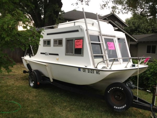 Cruisin Camper boat!  This way you wouldn't need a camper and boat.  Just use it as a camper, then drop in the water whenever you're ready!