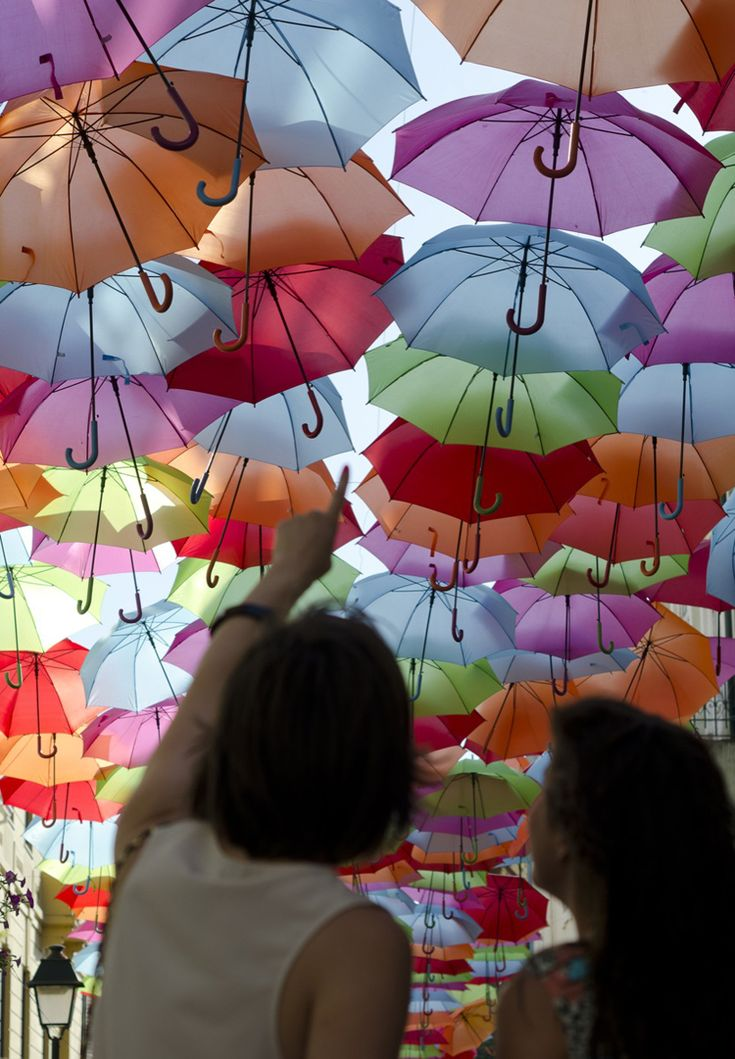 this is needed!!!  ivotavares studio: colorful umbrellas installation