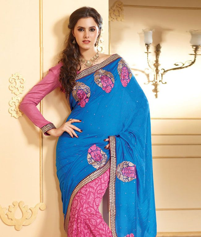 Turn on high style and class with this elegant piece. A swirl of pretty colours that are sure to captivate you as they blend among the intricate designs and leave that absolutely heavenly effect.BRAND: Strollay CoutureCATEGORY: Saree with Unstitched BlouseARTICLECOLOURMATERIALLENGTHSareeBlue and PinkCotton Viscose Mix 5.50 metersBlousePinkCotton Viscose Mix 0.80 meterWe would always want to send you what we showcase but there might be a slight variation in color due to photographic effects…