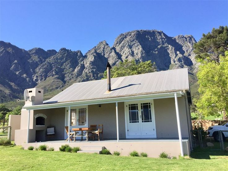 Olive Cottage - Welcome to Olive Cottage.Nestled in the Franschhoek Mountain Reserve lies a 2 bedroom self-catering cottage with exquisite panoramic views of the entire Franschhoek Valley and olive grove. It is on a private ... #weekendgetaways #franschhoek #winelands #southafrica