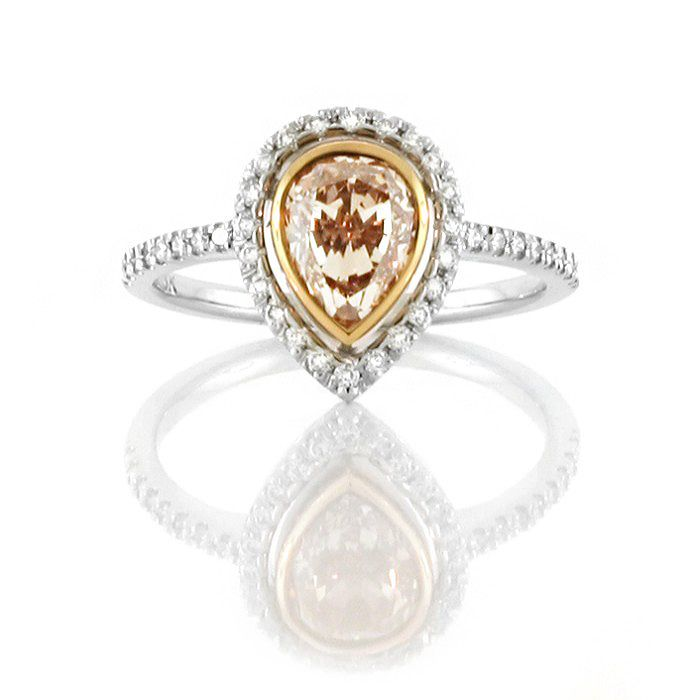 An 18ct White and Rose Gold Fancy Coloured Diamond Halo Ring with a Pinkish Brown Pear Shaped Diamond in the Center
