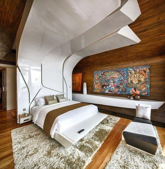 Schlafzimmer Wandgestaltung Holz Paneele übergroßer Bett