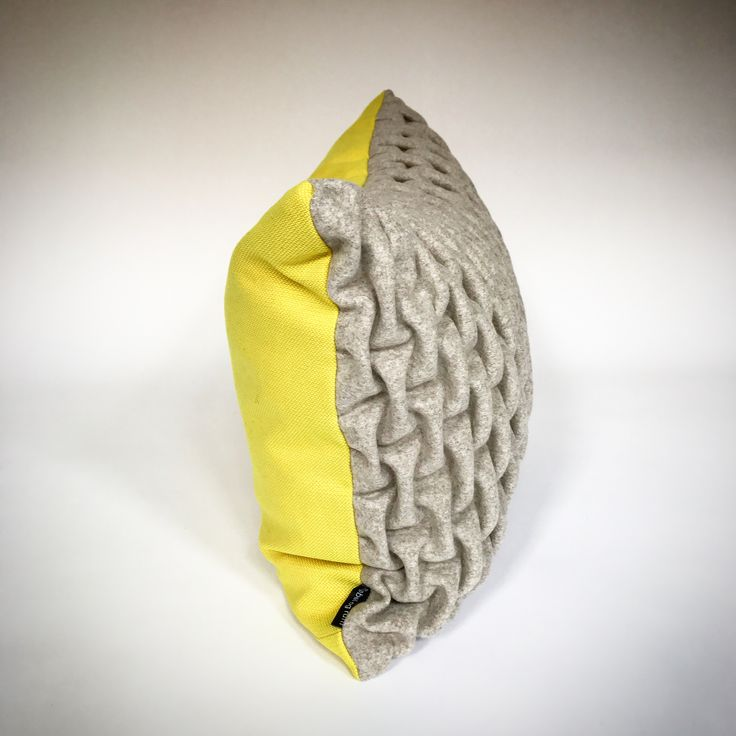 mobel of rum. SMOCK Cushion. Made by hand in Denmark. Yellow/beige. Kvadrat textiles.