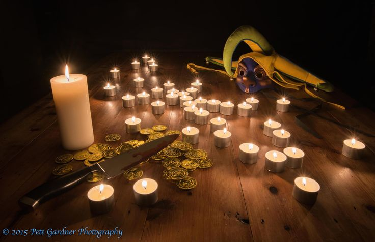 L2M1AS1Cd. Passion Play. Golden Triangle Candlelight. D810, Sigma 24mm Art Prime, 4 Sec, f/16, ISO 100, WB Manual, Shot at 2500K. Major elements (knife and line of candles) of image are set along lines and intersections of Golden triangle, Mask is at locus of golden ratio spiral. Shooting close created some distortion, partly corrected in LR, but I left some to create dreamlike effect. Knife was brightened with radial filter brush (FYI, That's pillar box red food colouring)